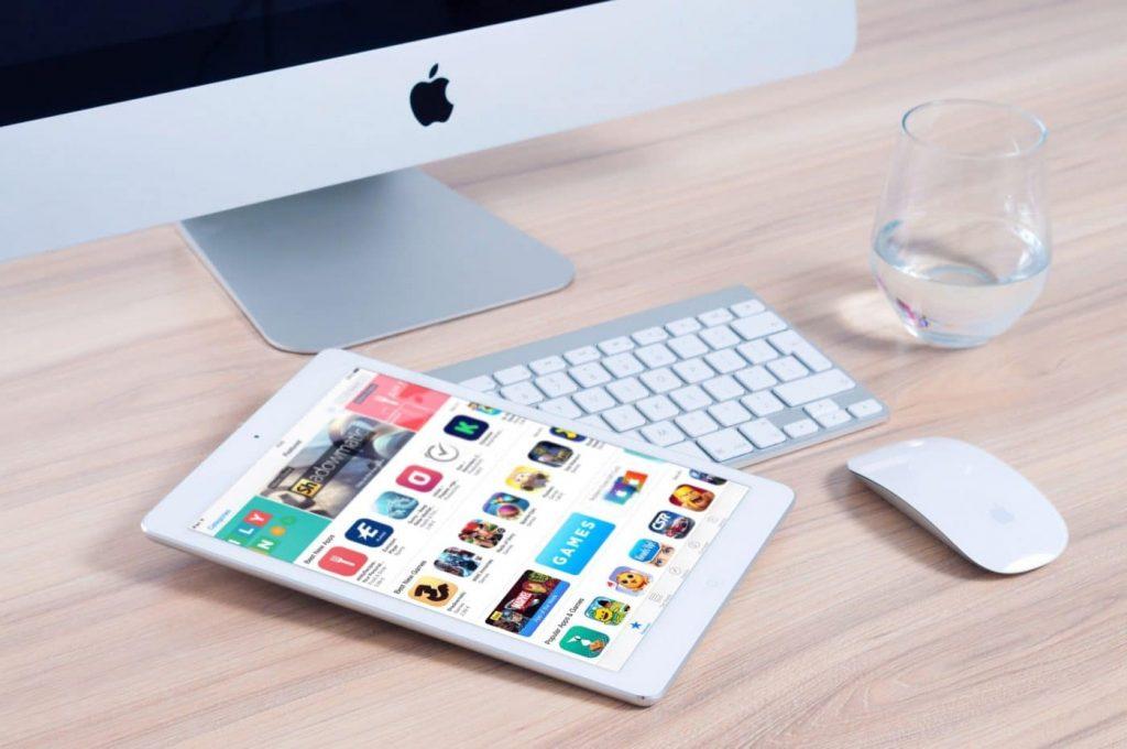 a tablet next to an imac computer