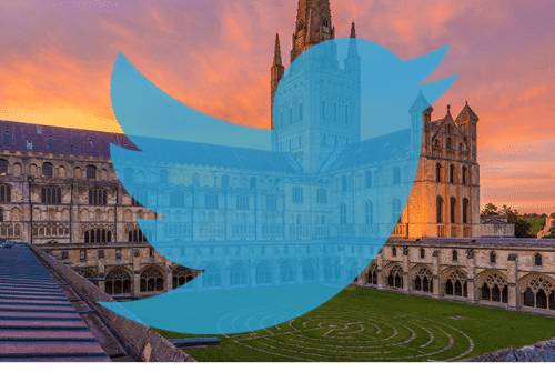 Twitter logo with noriwch cathedral in the background
