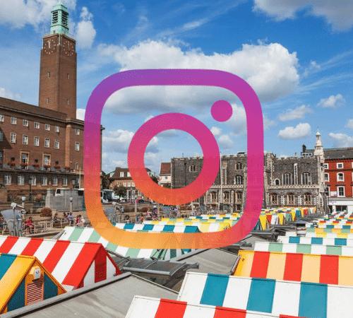 Instagram logo with Norwich market background