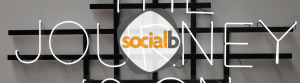 neon sign that says journey behind socialb logo